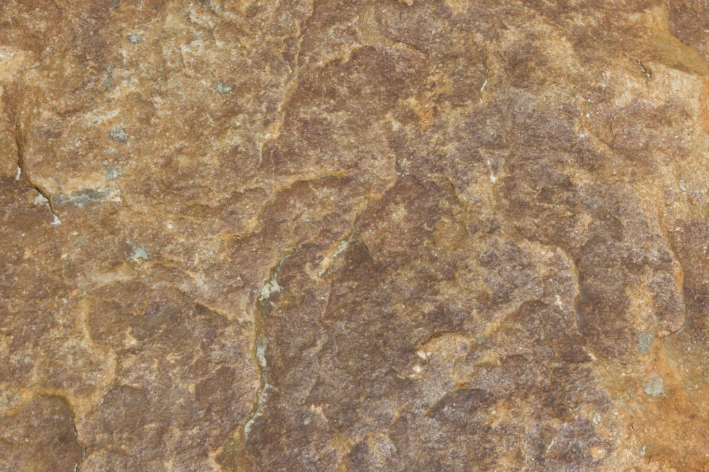 Orange brown rippled stone texture